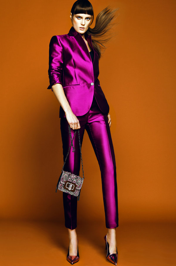 "Make a classic satin suit edgy and modern by popping the collar and adding mirrored shoes for a head-to-toe ""metallic"" look."